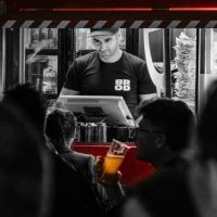 Capital brewing staff member takes orders for beer late at night
