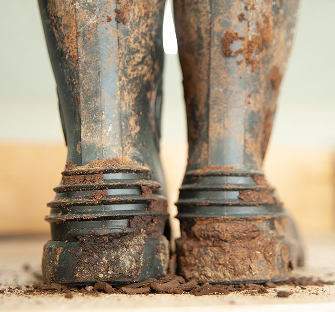 Olympia Yarger, founder and farmer. Photo of her gumboots.