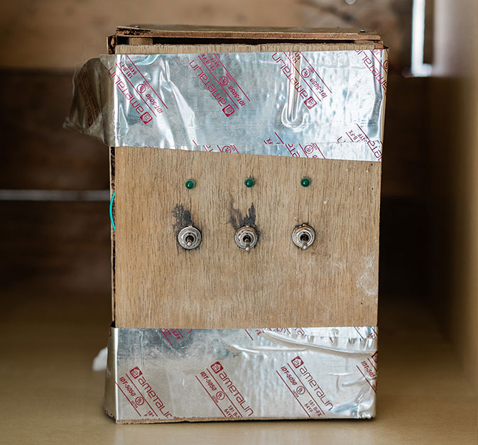 Photo of Olympia Yarger's early insect farming experimental equipment.